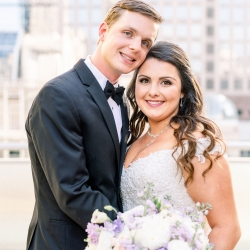 Bride and groom captured by Sunshower Photography during their spring wedding at Foundation for the Carolinas