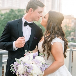 Sunshower photography captures a bride and groom as they prepare for their wedding in Uptown Charlotte