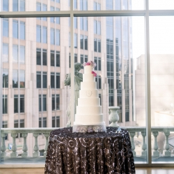 Stunning cake by WOW Factor is set atop beaded linens from CLux for a spring wedding in Uptown Charlotte