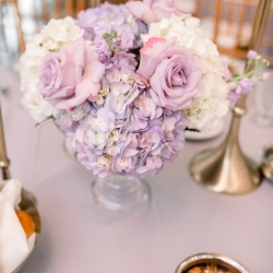 Centerpieces that featured lavender and white hues were the perfect touch created by Clux for a spring wedding in Uptown Charlotte