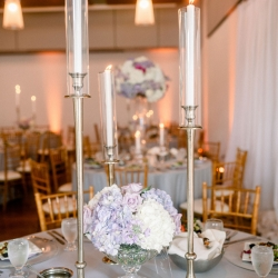 Tall candle light were the prefect romantic accents to a spring wedding at Foundation for the Carolinas captured by Sunshower Photography