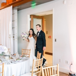 Bride and groom are surprised during a room reveal seeing the coordination of Magnificent Moments Weddings for the first time on their wedding day