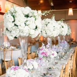 CLux created stunning tall and low centerpieces filled with white hydrangeas and lavender hues for a spring wedding at Foundation for the Carolinas