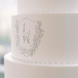 The couples initials are delicately displayed on a simple white cake by WOW Factor