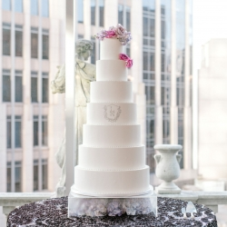 Sunshower Photography captures a massive seven tier cake by WOW Factor for a spring wedding at Foundation for the Carolinas