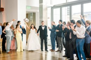 Bride and groom are introduced into their reception by Split Second Sound to enjoy their wedding at Foundation for the Carolinas
