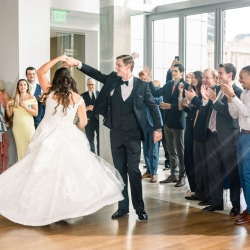 Groom twirls his bride during their wedding reception captured by Sunshower Photography at Foundation for the Carolinas