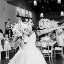 Bride has fun with her guests as they fill the dance floor to music provided by Split Second Sound during her spring wedding in Uptown Charlotte, North Carolina