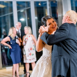 Bride dances with her dad during a sweet moment coordinated by Magnificent Moments Weddings
