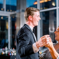 Groom shares a dance with his mother during reception coordinated by Magnificent Moments Weddings and captured by Sunshower Photography