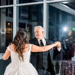 Bride shares a dance with her dad to music provided by Split Second Sound during a reception coordinated by Magnificent Moments Weddings