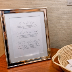 Custom sign reveals a donation instead of favors for a giving couples wedding at Foundation for the Carolinas
