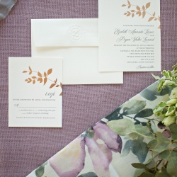 Invitation suite shows off garden accents and golden tones that complete their spring wedding coordinated by Magnificent Moments Weddings