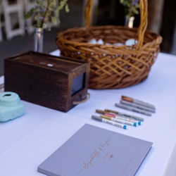 A sweet guest book allowed guests to add Polaroids and well wishes to the bride and groom on their wedding day