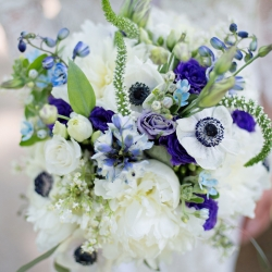 Bridal bouquet created by the brides aunt shows off delicate purple shades perfect for a spring wedding at The Ivy Place