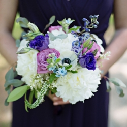 Floral bouquets feature whites and purples perfect for a garden spring wedding at the Ivy Place coordinated by Magnificent Moments Weddings