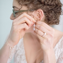 Bride shows of a braided hair style created by Cali Stott for her spring wedding at The Ivy Place