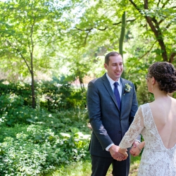 Bride and groom share a first look captured by The Beautiful Mess Photography in the gardens of The Ivy Place