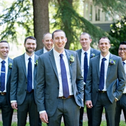 Groom poses with his groomsmen on the grounds of the Ivy Place during his spring wedding captured by The Beautiful Mess Photography
