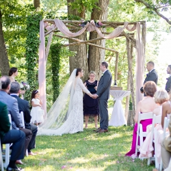 Bride and groom exchange vows during a wedding ceremony planned by Magnificent Moments Weddings and captured by The Beautiful Mess Photography