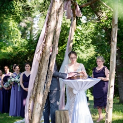 Bride and groom are married in a meaningful ceremony under a wooden arch in the gardens of the Ivy Place surrounded by their closest family and friends