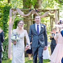 Bride and groom exit their ceremony coordinated by Magnificent Moments Weddings at The Ivy Place