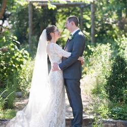 The Beautiful Mess Photography captures a loving couple on the grounds of The Ivy Place as they prepare for this spring garden wedding