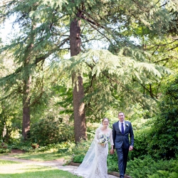 The Beautiful Mess Photography captures a bride and groom on the grounds of The Ivy Place as they prepare for their garden wedding ceremony