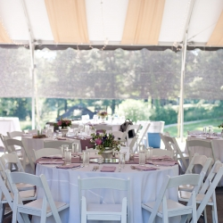 Simple white linens and purple napkins set the tone for a fresh spring garden wedding coordinated by Magnificent Moments Weddings in South Carolina
