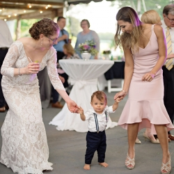Bride dances with a small guest to music by DJ Diamond Services during her spring wedding at The Ivy Place