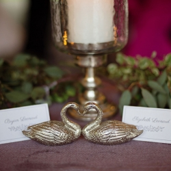 Custom place cards featured gold swans and were the prefect touch of elegance for a spring wedding at The Ivy Place captured by The Beautiful Mess Photography