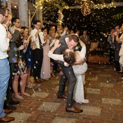 Bride and groom exit through a sea of bubbles to their new life as man and wife after their amazing wedding day planned and coordinated by Magnificent Moments Weddings