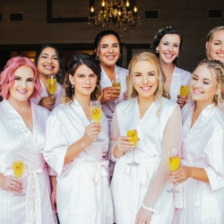 Alex Bee Photography captures a bride and her bridesmaids in matching robes as they prepare for her Tennessee Mountain wedding