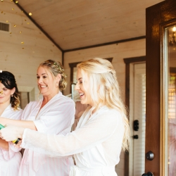 Bride celebrates her wedding at The Magnolia in Pigeon Forge Tennessee with her bridemaids