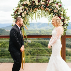 Alex Bee Photography captures a first look between a bride and groom during their fall mountain top wedding