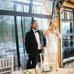 Bride and groom get a sneek peak of their reception space coordinated by Magnificent Moments Weddings