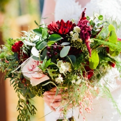 Stunning bridal bouquet by LB floral features deep red and blush toned flowers