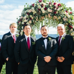 Groom poses with his bridal party during a fall mountain wedding captured by Alex Bee Photography