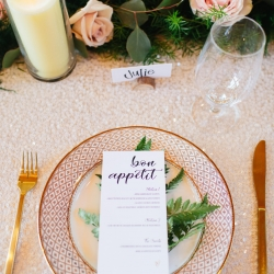 Vintage plates with green ferns and custom menus created a stunning place setting for a fall wedding in the Tennessee Mountains coordinated by Magnificent Moments Weddings