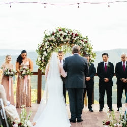 Bride is given away by her father during her fall wedding at The Magnolia during a ceremony coordinated by Magnificent Moments Weddings