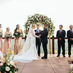 Bride and groom exchange vows at The Magnolia while overlooking the stunning Pigeon Forge Mountains