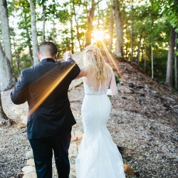 Bride and groom ascend a path in the Tennessee Mountains with Alex Bee Photography to capture stunning pictures during their fall mountain wedding