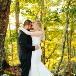 Alex Bee Photography captures a loving moment between a bride and groom in the Tennessee Mountains after their wedding ceremony coordinated by Magnificent Moments Weddings