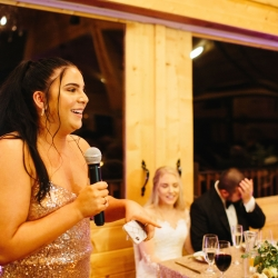 Bridesmaid gives a touching toast during the couples wedding reception at the Magnolia in the Tennessee mountains