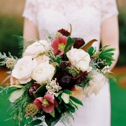 Bridal bouquet created by Jimmy Blooms features blush flowers and accented by deep burgundy and green accents