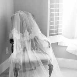 Ally and Bobby Photography captures a detail shot of a brides stunning lace accented veil