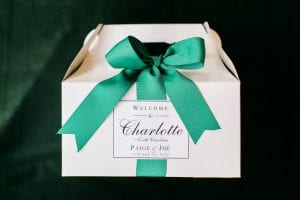 Custom welcome boxes great guests as they celebrate a winter wedding at Carmel Country Club in Charlotte, North Carolina