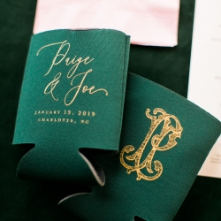 Custom koozies of emerald green show off a couples wedding date and serve as memorable favors