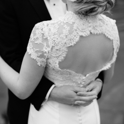 Ally and Bobby Photography captures a detail shot of a brides stunning dress with lace details