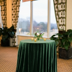 Deep emerald velvet linens accent stunning cocktail tables for a wedding at Carmel Country Club